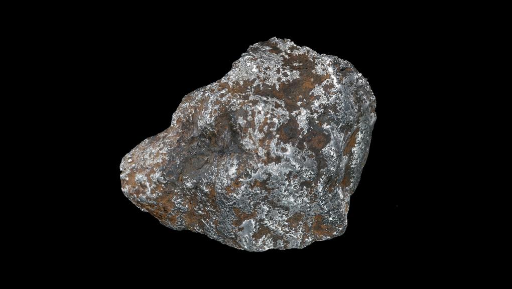 Pépite de Platine natif enduite partiellement de limonite (N° 57.359) © MNHN - Louis-Dominique Bayle