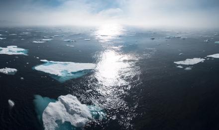 Icebergs on body of water during daytime © William Bossen on Unsplash